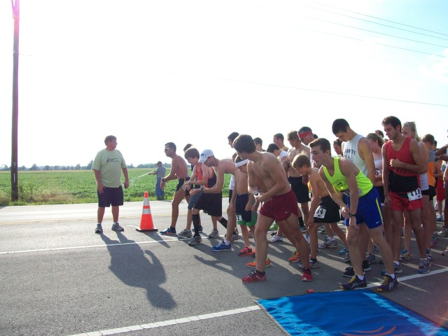Chad Ware, shown here on the left issuing instructions for this summer's Gator Gallop 5K, is training for a 100-mile race.