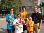Family runners pose with race starter Grandpa