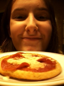 Cassie can't wait to try her 1-point snack pizza.