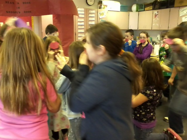 Colleen and her classmates play a game at her Valentine's party.