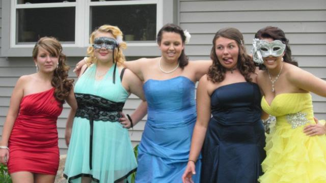 And Talisha last May at the Norwell prom, second from left, next to Rowan (in the red)