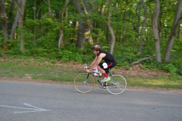 Ben returns from the 20K bike segment.