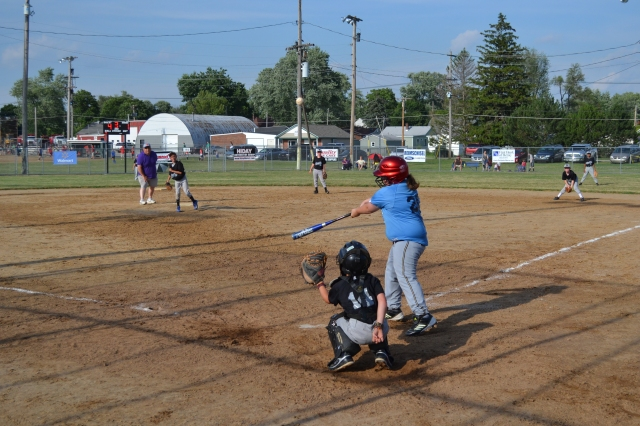 I love baseball! I play first base and lately I've been pitching, too. Here's me getting a hit at last night's game.