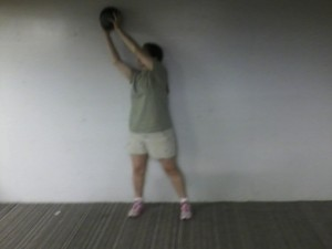 Reach up over your shoulder with a medicine ball ...