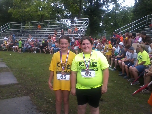 My friend Sarah and I with our Iron Kid medals.
