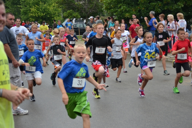 11-year-old Connor Torson, No. 63 in the black shirt, torched the competition in the kids race with a 5:50 mile.