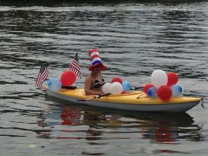 OK, looks like Traci did take a pic of Madison -- in the kayak parade, not in her running shoes...