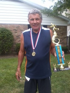 Doug Bauman, 66, is one of 2 runners to have competed in all 40 races. He displayed his trophy collection at the race and picked up another one this year with a time of 23:59.