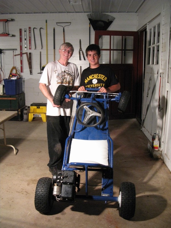 Ben restored this 1960s Sears go-kart for his 4-H small engines project this year, with help from Uncle Rick. The engine came from Grandpa's old sprayer. He won Grand Champion at the local fair and a blue ribbon at state, even though they didn't let him take the go-kart itself, just a poster that accompanied it.