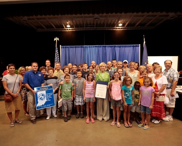 Lt. Gov. Becky Skillman poses with a few dozen members of the Isch family at the 2012 Hoosier Homestead ceremony. Hubert is at Skillman's 2 o'clock.