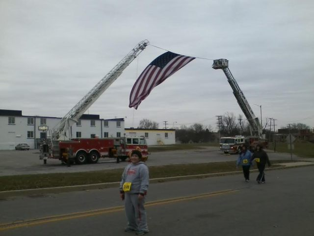 I thought it was cool that these firetrucks displayed this huge flag near the end. But wow, was I tired (and cold!) by this point in the race!