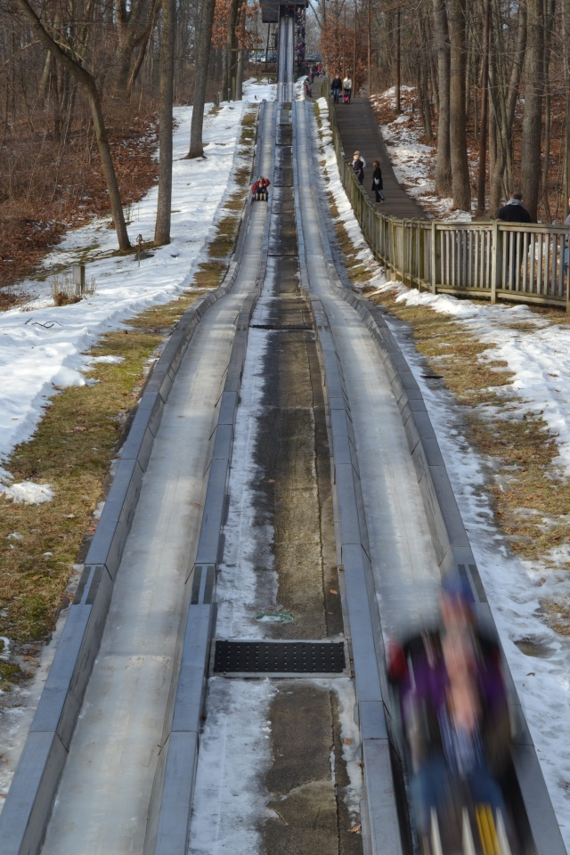The toboggan run at Pokagon State Park turns out to be exactly 1/4 mile from the end of the line to the stairs at the top.