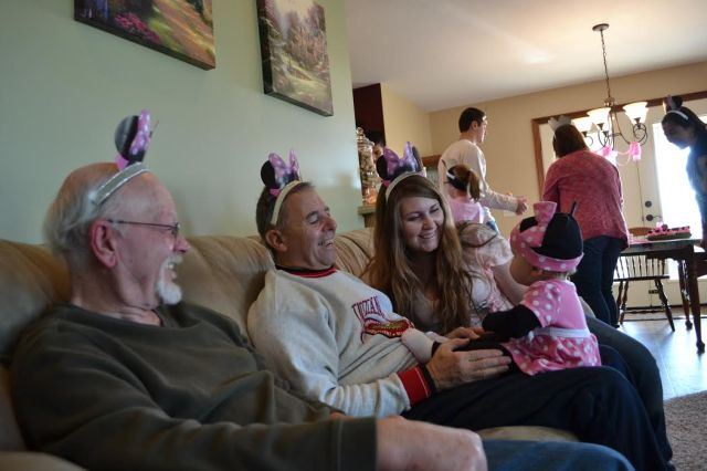 Both grandpas donned pink Minnie Mouse ears for the birthday girl's festivities.