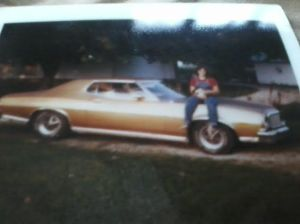 "Lap 74, aka ""1974,"" reminded me the '74 Gran Torino that later became my first car sometime in the early '80s. That's me around age 17, holding some random cat."
