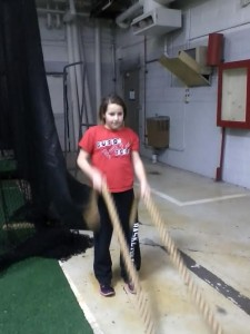 My niece Monroe demonstrates the heavy ropes workout that my son Ben uses in his baseball conditioning.
