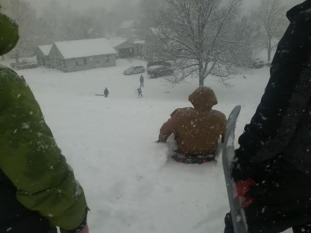 Ben gets ready to sled down the big hill at Markle early Sunday afternoon while Colleen and their cousin Mason wait their turn.