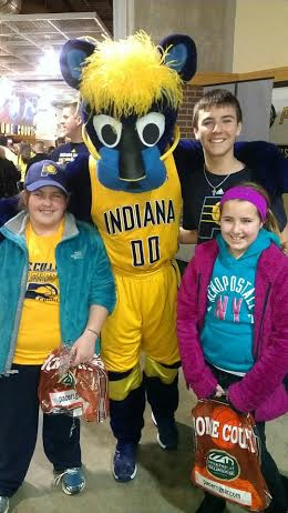 Colleen and her cousins Max and Monroe chill with Boomer, the Pacers' mascot.