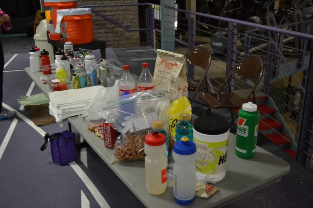 One of the DIY refueling stations at the Maple Leaf Indoor Marathon. It was quite the mix, ranging from the usual fare to some runners' stashes of  Twix bars, Snickers bars, pretzels and even tortilla chips.
