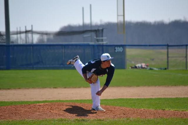 Ben pitching during last weekend's junior varsity doubleheader. He threw the last two innings of Game 1, then started and pitched the first four innings of Game 2 for the win.