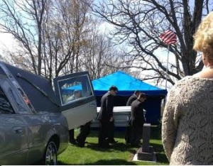 My brothers and cousins carry Dan's casket at the cemetery on a gloriously sunny day that defied the forecasts.
