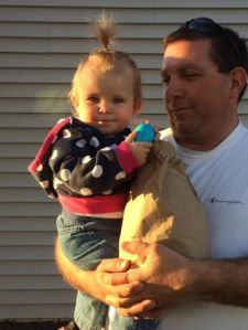 My brother Brent and niece Kyla with her bag of goodies after the Easter Egg Hunt. (Luckily, hers wasn't as hard to find as some of the older kids, one of whom found hers in the corn field, covered with husks!)