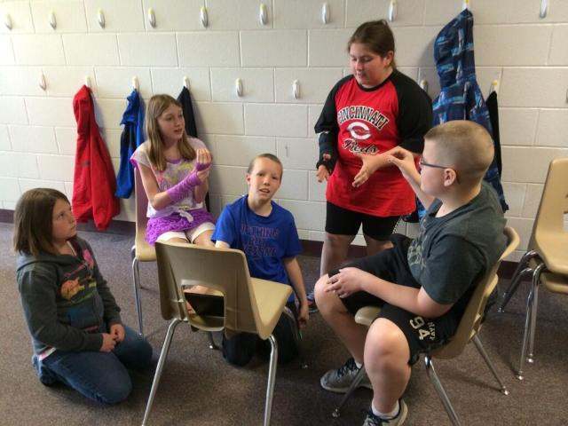 """I'm explaining an idea to my editing team for our class iMovie, """"Earth: Help Save It."""""""