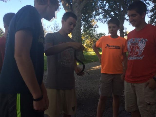 This snake that showed up at the cross country team's pasta dinner didn't get me too worked up, but I'm still working on dealing with the ones I encounter on the trail.