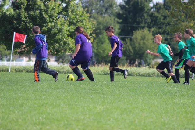 Here I am playing soccer last Saturday after our cross country meet in Marion.