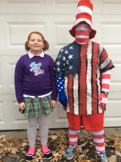 "My friend Olivia and I went trick-or-treating in the cold  rain and snow on Halloween. She was an awesome Darla from  ""Finding Nemo"" and I went as ""Old Glory."" (One person whose house we went to said I was Miss America! Isn't that hilarious!)"