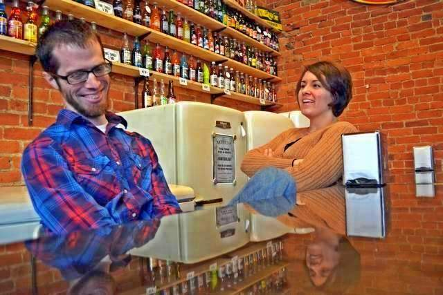 Adam and Rebecca Hanson, proprietors of Antiqology in Huntington, Ind. They say they carry the Midwest's largest selection of craft soda.