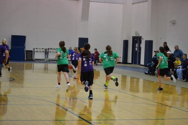 You know what I like about this picture? I'm not the last person down the court anymore! (That's me in the neon Nike Elite socks during our game last week.)