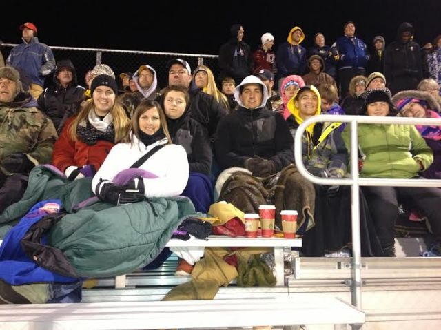 """The gang """"chills"""" at the game, literally. (Notice the Starbuck's cups beside Traci.)"""