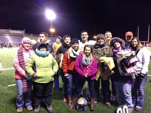 Garrett poses with his fan club after the game.