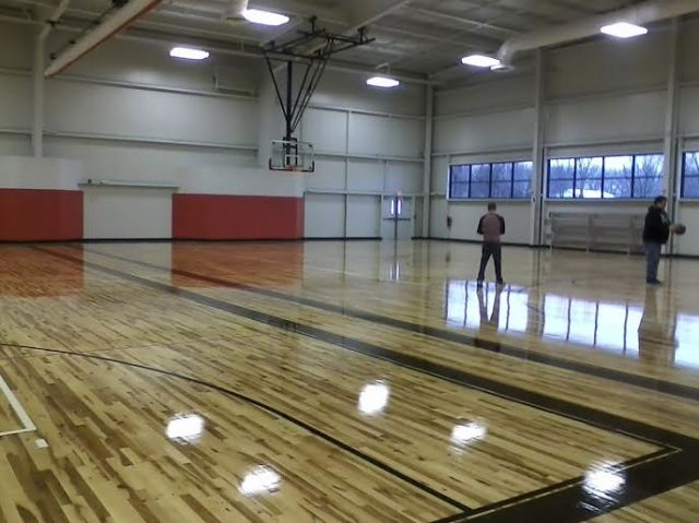 The paint fumes in the double-wide gym were still so strong I don't think I could've stayed in there for long. But it looks nice, especially with those windows.