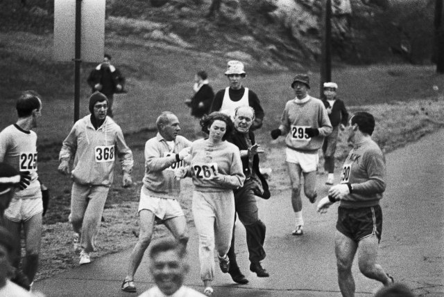 Kathrine Switzer being attacked by race director Jock Semple for daring to run the 1967 Boston Marathon.