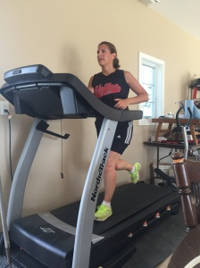 My sister Traci on the treadmill in our parents' garage. This was an 8 mph quarter mile, which produces a 1:52.