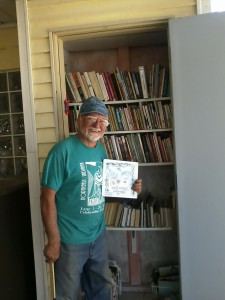 "Larry, one of the Lions Club guys that helps care for the Zanesville not-so-little free library, was organizing books at the ""outhouse"" when I arrived."