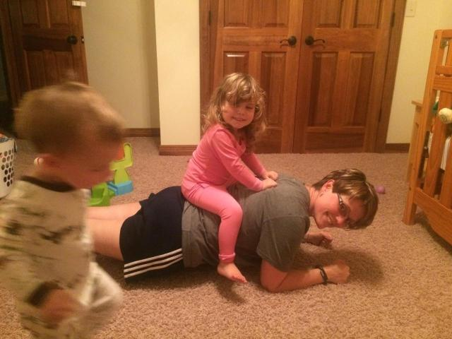 Kyla helps my sister-in-law Darcy with her plank the other day.