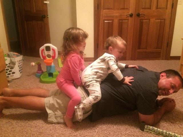 2-year-old Kyla nd 1-year-old Kobi help my brother Brent get his plank in.