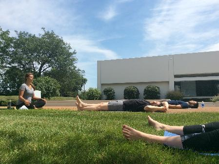 Yoga instructor Megan Hunter, left, leads a session at Regal Beloit's Fort Wayne campus.