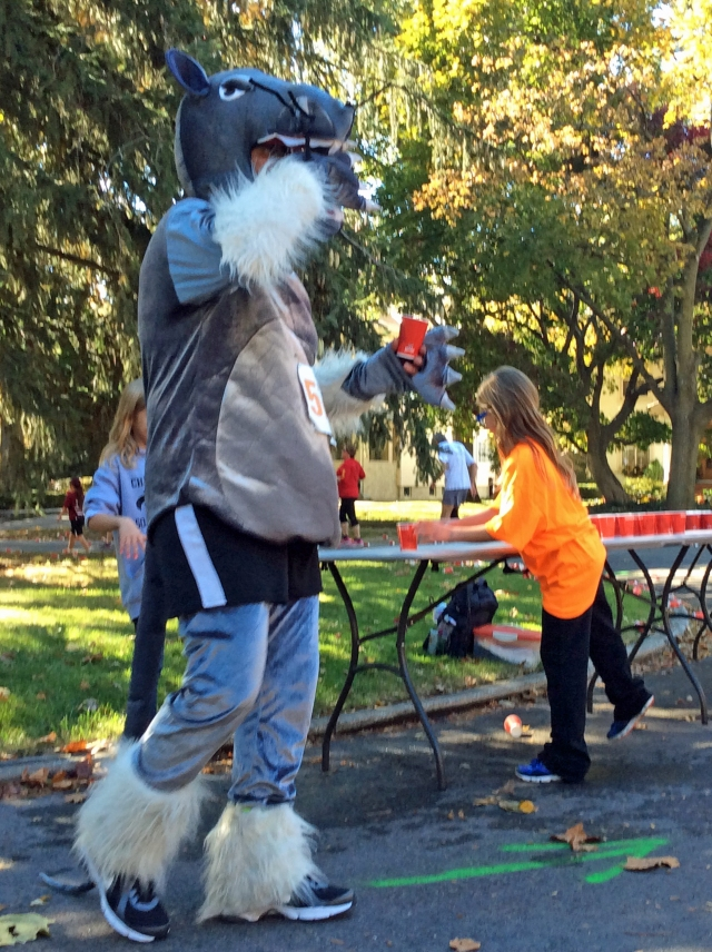The official mascot of the River City Rat Race takes a water break at the halfway point of the 5k course.